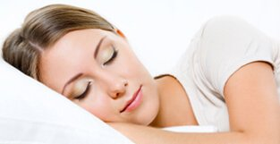 Woman in white tshirt sleeping soundly